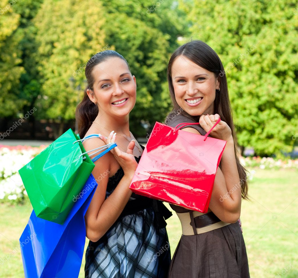 Two pretty women with bags in park  Stock Photo #5157083