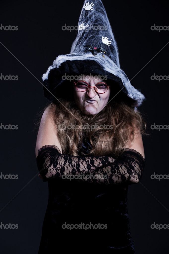 Portrait of witch over dark background. halloween theme  — Stock Photo #5158133