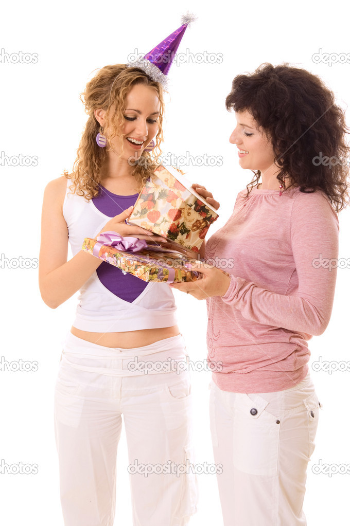 One girl presenting to another birthday gifts. isolated on white — Stock Photo #5158416