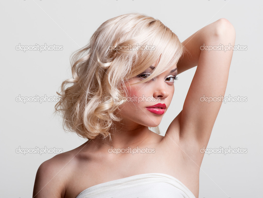 Portrait of alluring model against grey background — Stock Photo #5158625