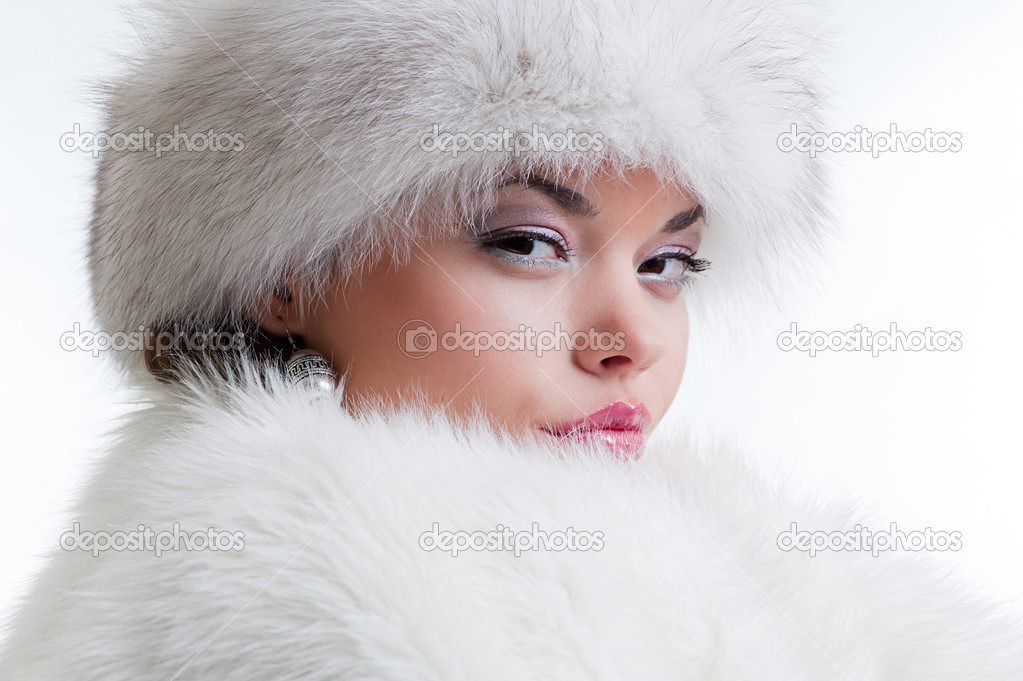 Winter portrait of attractive woman in white fur — Stock Photo #5158769