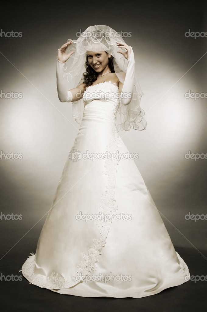 Attractive young bride in full-length   Stock Photo #5159917