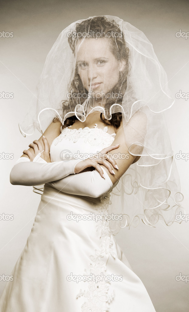 Beautiful bride hiding her face behind an wedding veil — Stock Photo #5159975