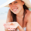 Beautiful woman with small crab in her palms — Stock Photo #5160062