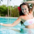 Beautiful young woman in the pool — Stok fotoğraf