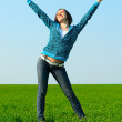 Carefree girl showing thumbs up — Stock Photo #5160115
