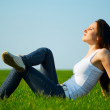 Carefree girl sitting at the field — Stock Photo #5160117