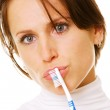 Closeup of thinking woman with toothbrush — Stock Photo #5160151