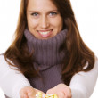 Happy woman with pills in hands — Stock Photo