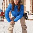 Pretty woman on ski resort — Stock Photo