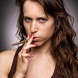 Serious woman with cigarette - Stock Photo