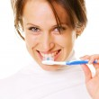 Smiley young woman cleaning her teeth — Stock Photo