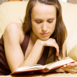 Woman reading novel at haome — Stock Photo #5160895
