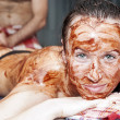 Woman taking chocolate massage - Stock Photo