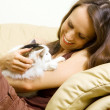 Woman with her pet at home — Stock Photo