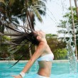 Woman with wet hair in the pool — Stock Photo #5160994