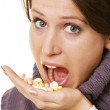 Young woman eating pills — Stock Photo #5161098