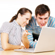 Man and woman looking in to the monitor of laptop — Stock Photo #5161232