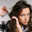 Stock Photo: Beautiful womcutting her hair