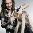 Stock Photo: Smiley hairdresser doing hairstyle
