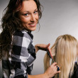 Smiley hairdresser with client - 图库照片