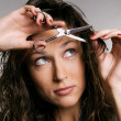 Stock Photo: Young woman cutting her fringe