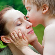 Stock Photo: Son kissing his mother
