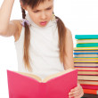 Stock Photo: Pensive young girl with books