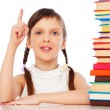Pupil with books over white background — Photo