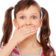 Small girl covering her mouth - Stock Photo
