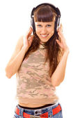 Pretty brunette in headphones — Stock Photo