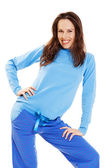 Pretty young woman in blue pyjamas — Stock Photo
