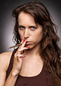 Serious woman with cigarette — Stock Photo
