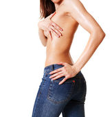 Sexy woman in blue jeans — Stock Photo