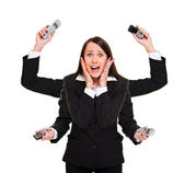 Stressed woman with telephones — Stockfoto