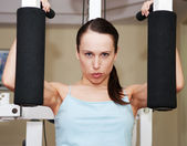 Woman doing exercises to develop muscles — Stock Photo