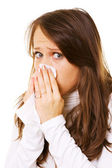 Young woman blow one's nose — Stock Photo