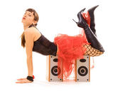 Young woman lying on speakers — Stock Photo