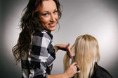 Smiley hairdresser with client — Stock Photo