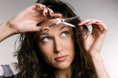 Young woman cutting her fringe — Stockfoto