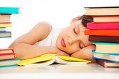 Fatigued schoolgirl sleeping on book — Stock Photo