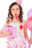 Joyous girl with balloons and gift box — Stock Photo