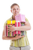 Handsome man with motley gift boxes — Stock Photo