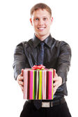 Smiley man holding gift — Stock Photo