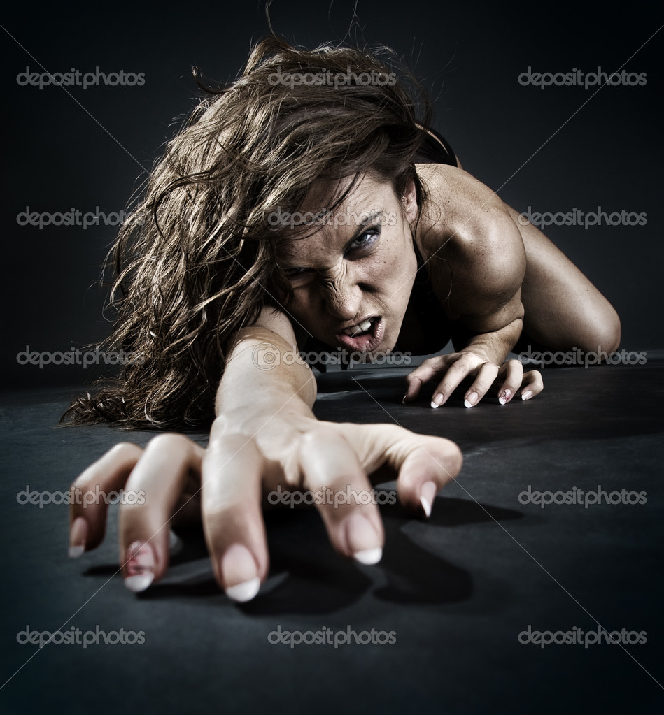 Evil woman creeping from dark — Stock Photo #5160194