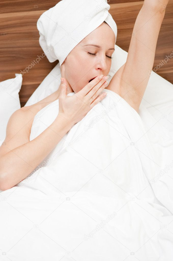 Attractive woman yawning at the morning  Stock Photo #5161010