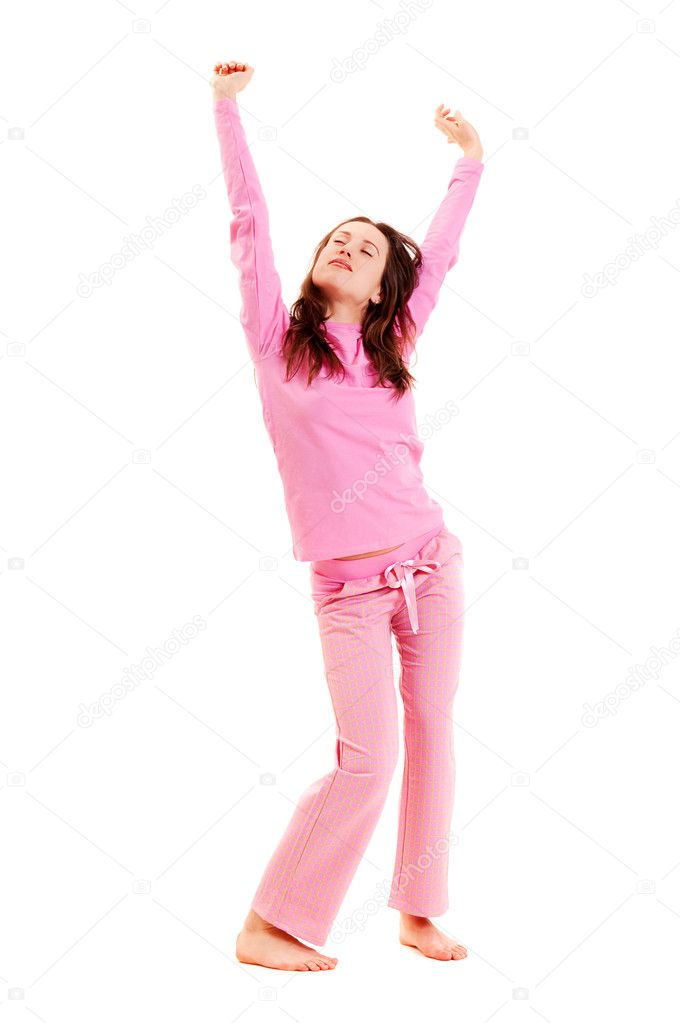 Young woman in pink pajamas against white background — Stock Photo #5161119