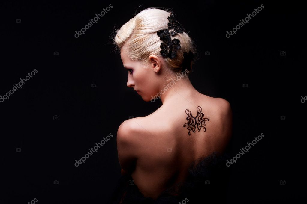 Portrait of sexy woman with tattoo on her back — Stock Photo #5161313