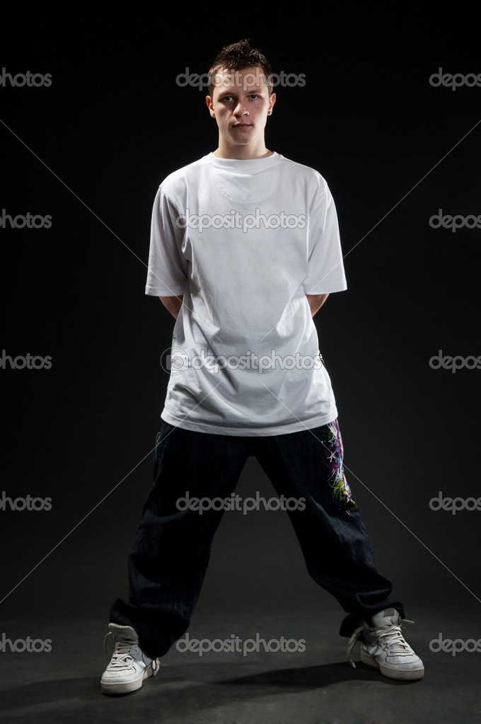 Breakdancer in white t-shirt standing against white background — Stock Photo #5162025