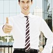 Stock Photo: Businessman showing thumbs up